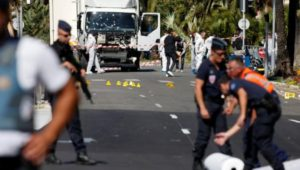 French police secure the area as the investigation continues at the scene near the heavy truck that ran into a crowd at high speed killing scores who were celebrating the Bastille Day July 14 national holiday on the Promenade des Anglais in Nice